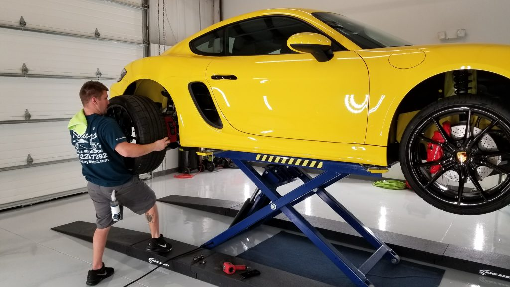 Putting the wheel on a Cayman