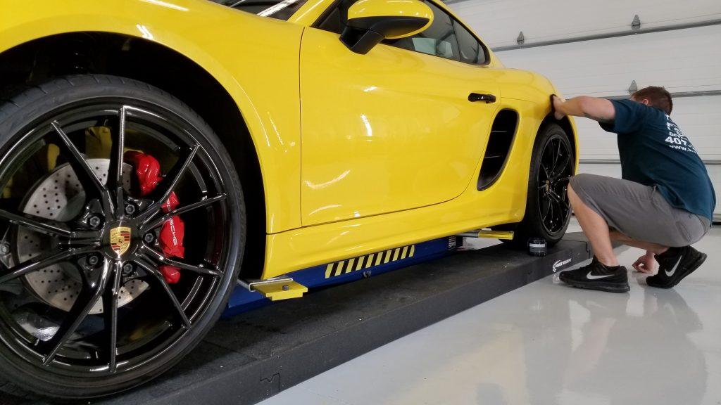 Applying Zuffenhausen premium wax to Porsche Cayman