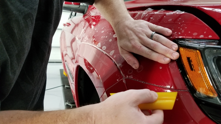 Installing ppf with a yellow squeegee