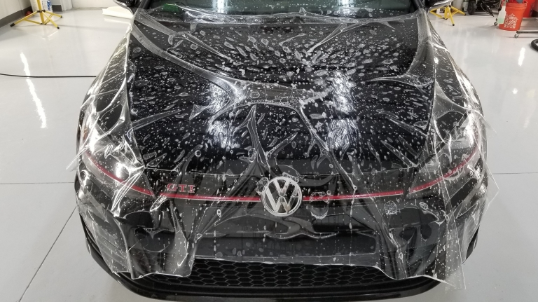 Full hood paint protection film with wrapped edges