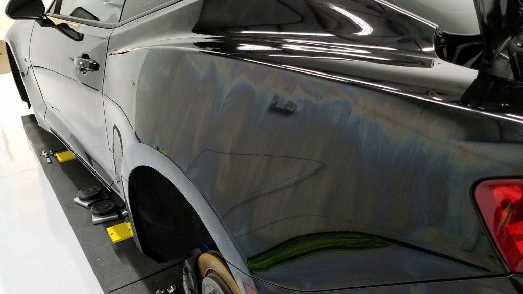 Ceramic Coating flashing on a rear quarter panel